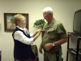 Peggy Vanyo presented Bill his Vietnam Veteran lapel pin.